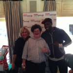 Photo bomb by Kathy with Go Daddy star and Atlanta Falcons Brian Banks.